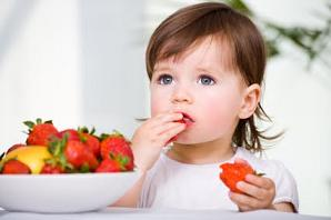Photo of a child eating strawberries