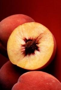Photo of peaches cut in half