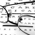 Photo showing glasses and an eye test