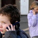 photo of children on mobile phones