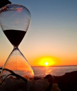 Photo of an hourglass and a sunset