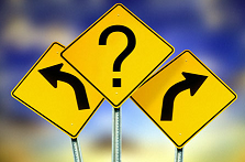 Photo of road signs pointing in different directions
