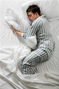 Photo of a man asleep in bed