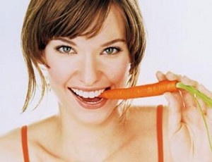 Photo of a wonam eating a carrot
