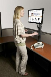 Photo of a woman at a standing desk