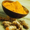 Photo of a bowl and root of turmeric