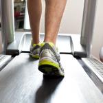 Photo of feet walking on a treadmill