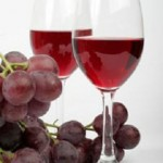 photo of grapes and a glass of wine