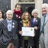 Handing the Letter from America in at Downing St
