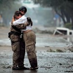 First responder comforts a victim of natural disaster