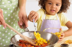 Photo of parent & child cooking