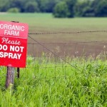 photo of a no pesticides sign on an organic farm