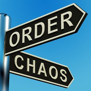 Photo of a sign pointing to order and chaos