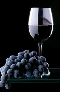 Photo of grapes and a glass of red wine