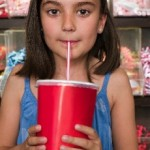 photo of a young girl drinking soda