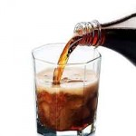 photo of cola being poured into a glass