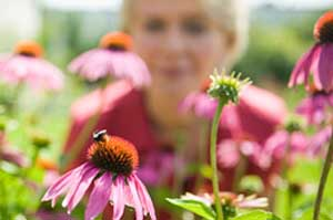photo of a women in a field of flowers