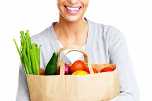 woman with a bag of healthy groceries
