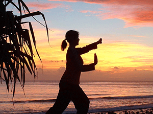 photo of a woman pracicing tai chi