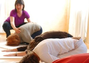 Photo of a group of people practicing yoga