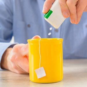 photo of man using sweetener